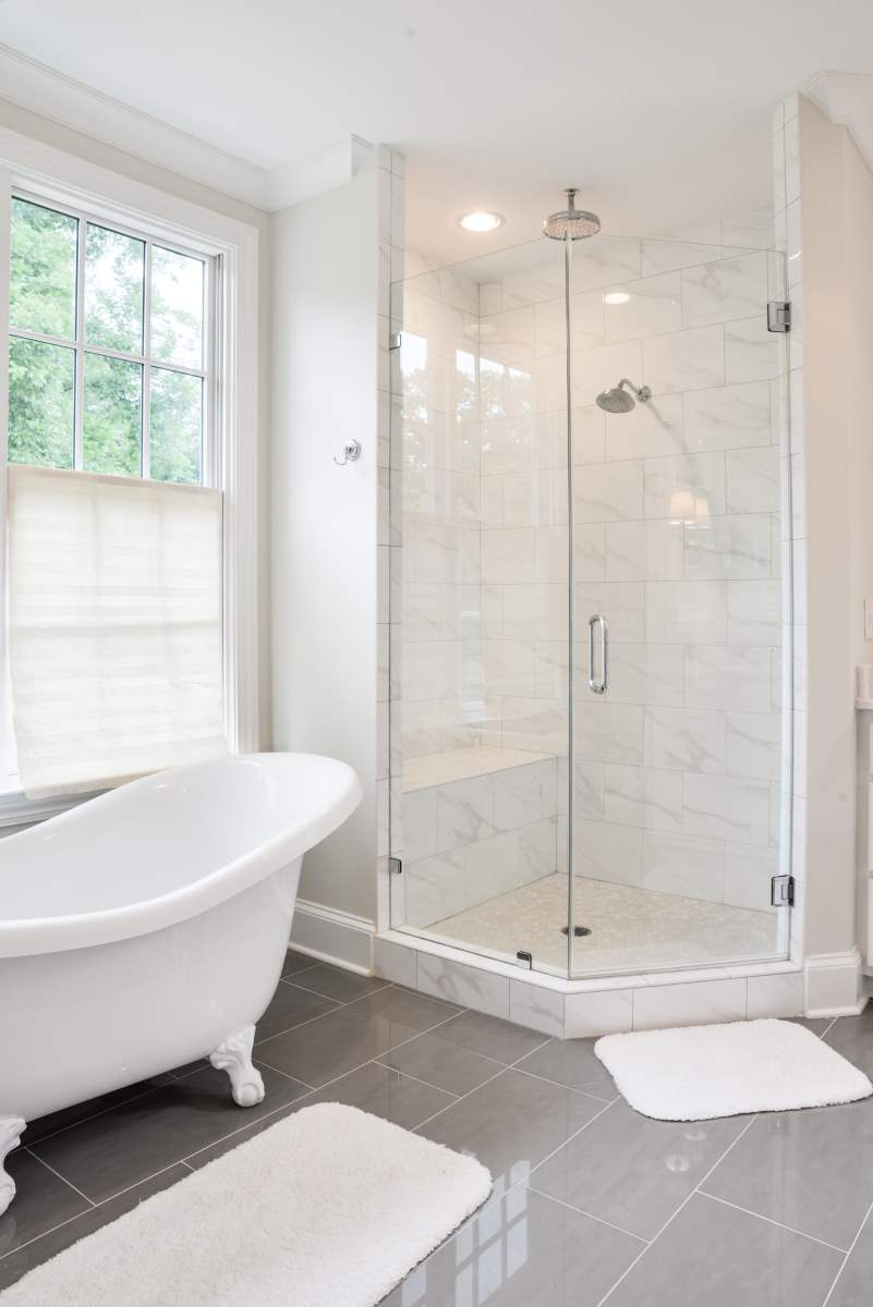 Marble Tile Shower and Claw Foot Tub | Artistic Contractors