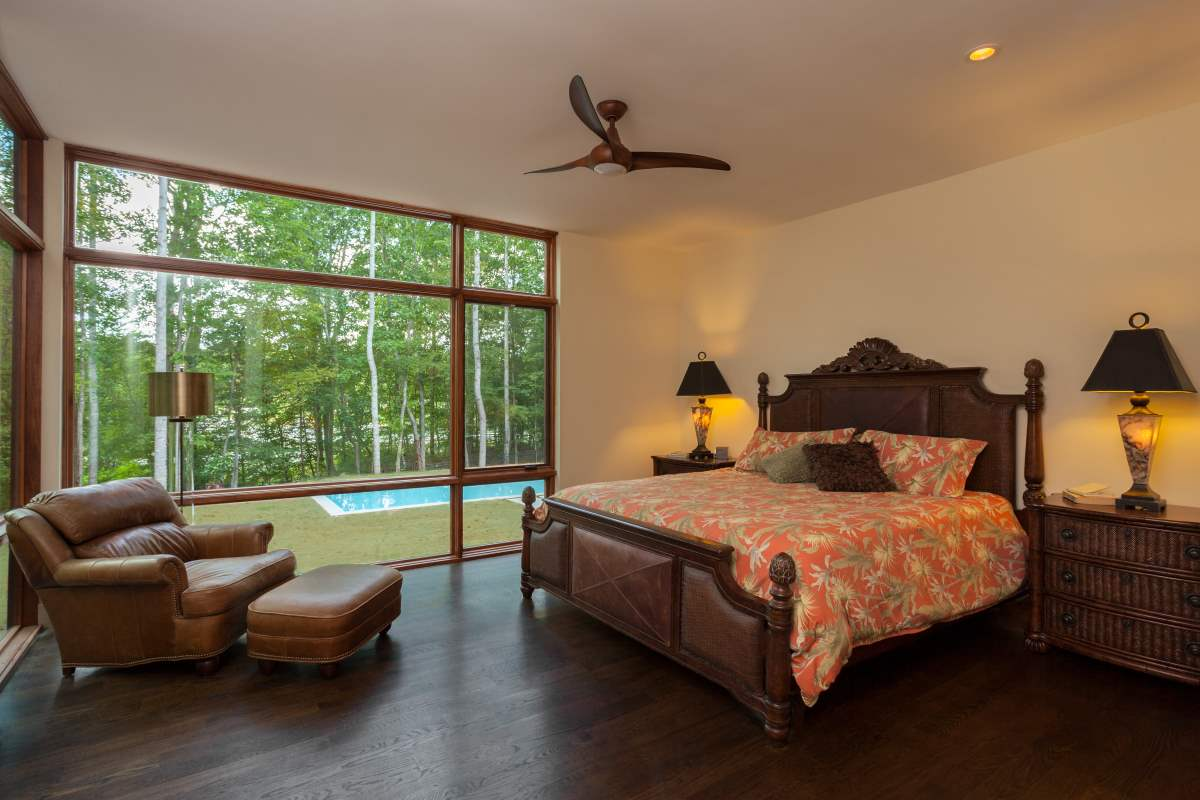 Master Bedroom With Large Windows