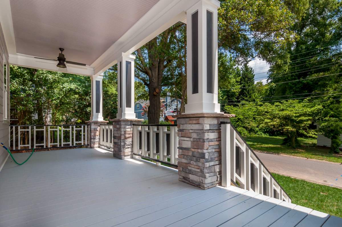 Front porch with stone columns artistic contractors